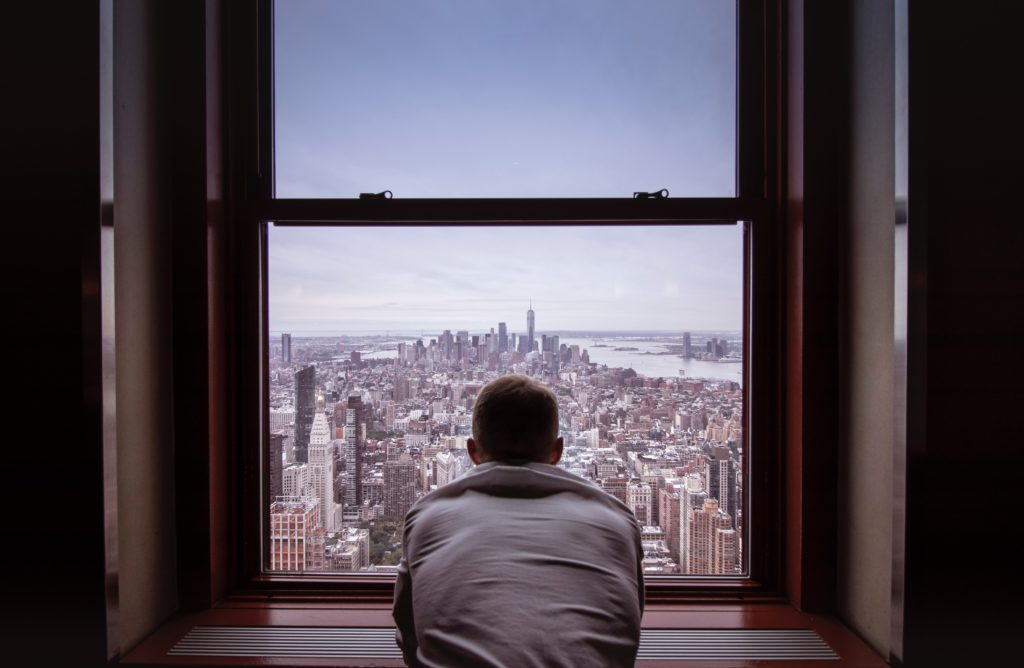 Man staring out window; New York City